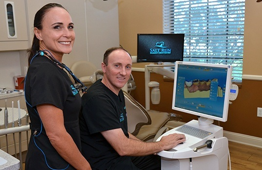 Dentists looking at digital smile design tools