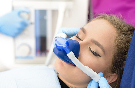 Patient with nitrous oxide dental sedation mask