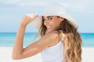 woman on the beach enjoying the summer sun