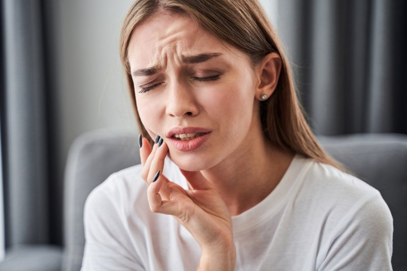 young woman experiencing dental emergency